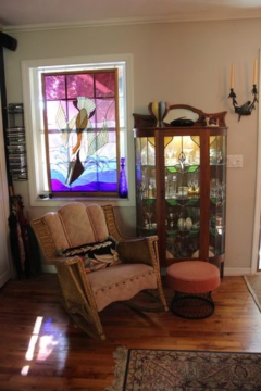 (3) The Sobczak/Heuer home features Charles' stained glass and treasures from the past