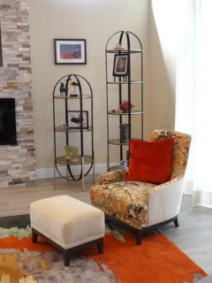 Living-room furniture in dramatic color scheme with custom-designed rug