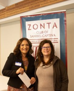 F.I.S.H. Social Services Director Nitza Lopez (L) receiving her 2020 grant award last January from Zontian Kelly Turnage