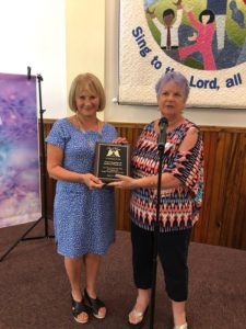 From left, Zonta co-liaison Erika Steiner receives a plaque of appreciation from Dr. Helen Gierke, President of Angel Wings of SW Florida, Inc.